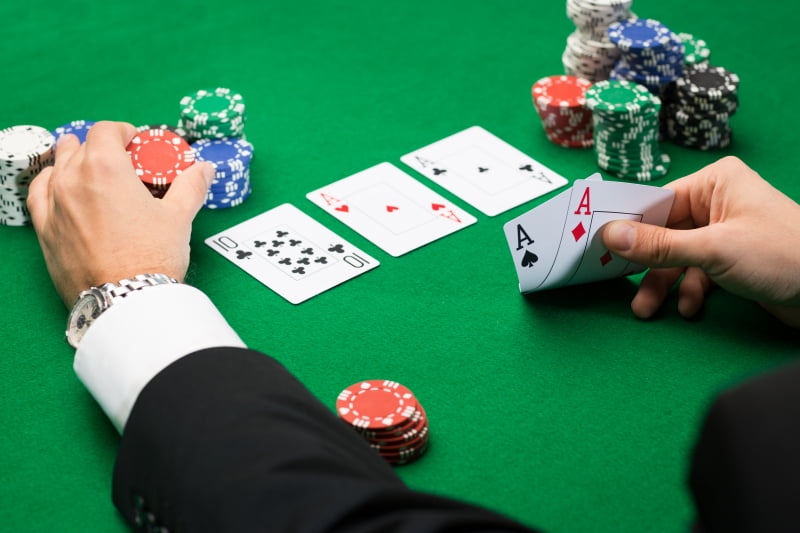 Poker-player-with-cards-ok