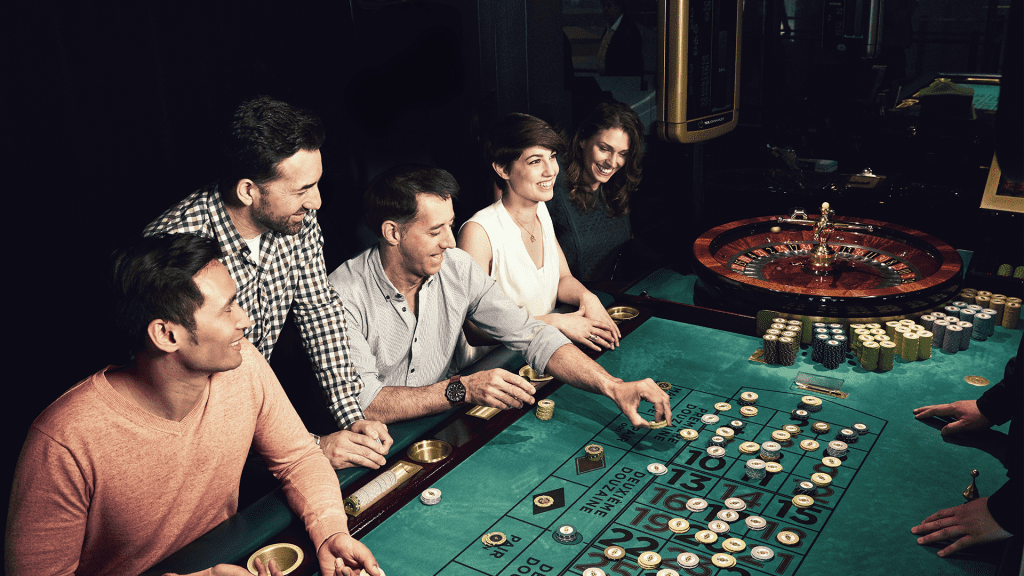 group of people enjoying a round of roulette together, smiling