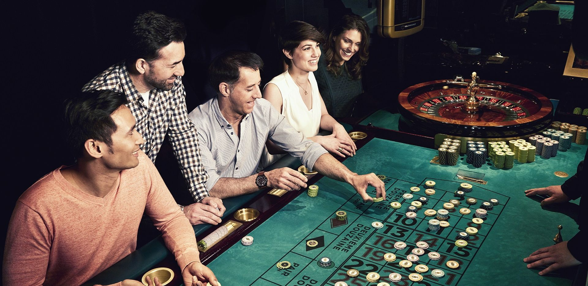 a group of people playing roulette